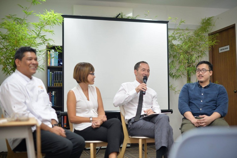 simon-cleaver-talking-amongst-a-panel-of-staff-at-osac