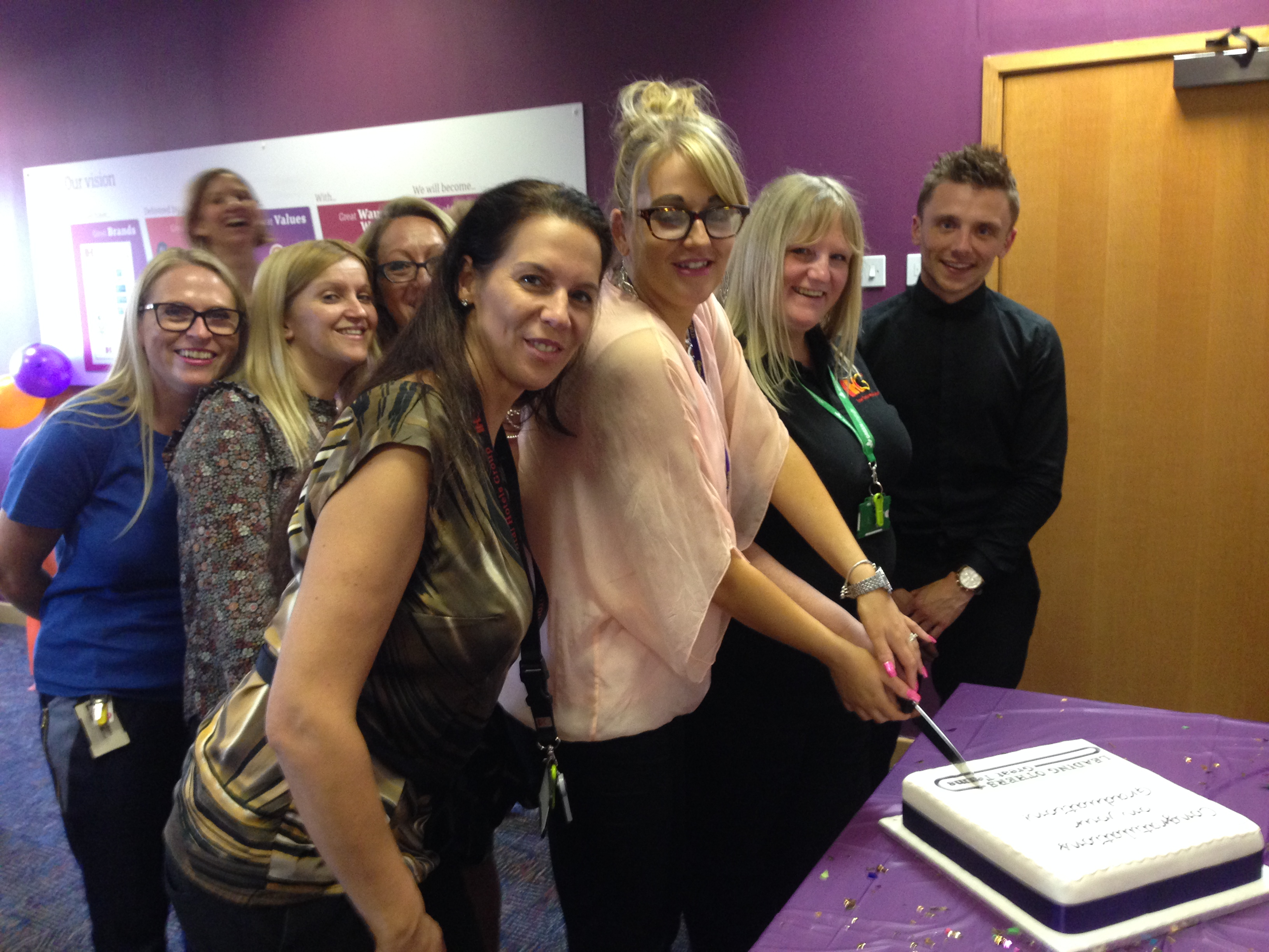 UK Central Reservation Office cutting cake