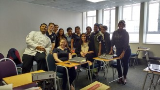 Carlo Lopes posing with some International Hotel School (Cape Town) students