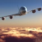 bigstock-Passenger-plane-above-the-clou-50985044