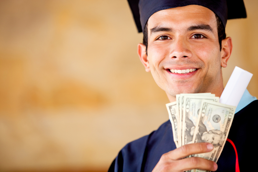 bigstock-Male-graduated-holding-money--29868566