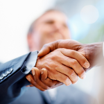 bigstock-Business-Men-Shaking-Hands-Ove-5118881