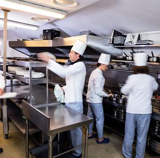 bigstock-Team-of-chefs-preparing-food-i-135995933