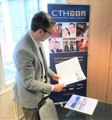 stefano-reading-the-cth-brochure-1