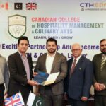 Male and female representatives of Canadian College of Hospitality Management & Culinary Arts (COHMCA) in Pakistan, posing with CTH approval certificate.